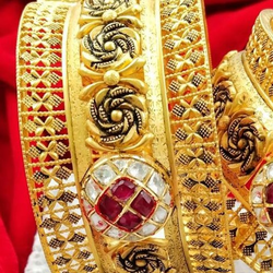 gold bangle by