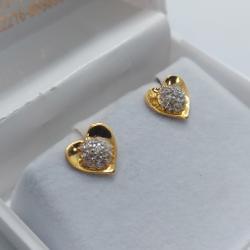 Earrings by Parshwa Jewellers