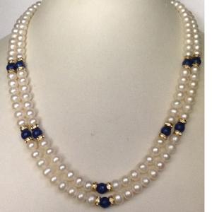 Freshwater white round pearls with chakri nec