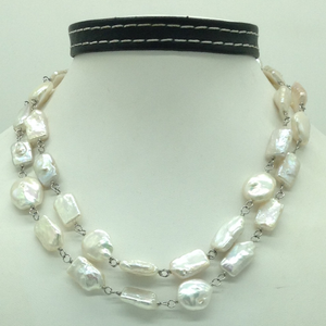 Freshwater white baroquepearls with silver