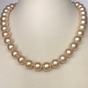 Freshwater orange round pearls strand