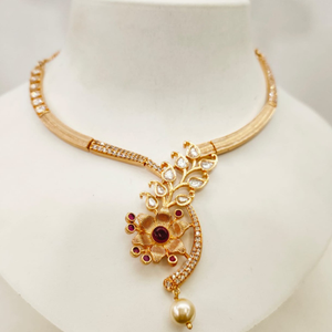 Fancy gold tone flower design & diamond n