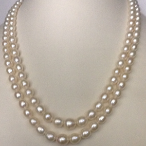 Freshwater white oval graded pearls necklace