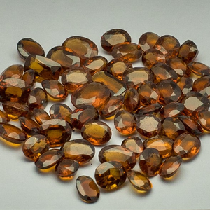 145.790ct oval brown hessonite-gomed