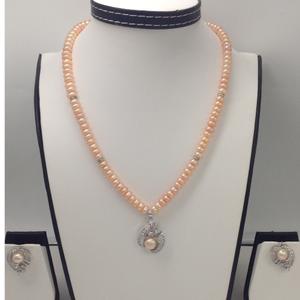 Whitecz and orange button pearl pendentse
