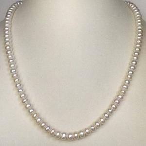 Freshwater white flat pearls strand