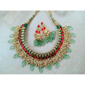 Pink and green kundan gaadi set with beautifu