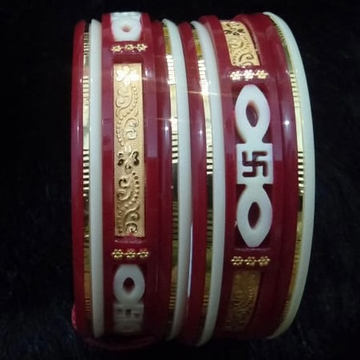 Gold swastik design plastic bangle by