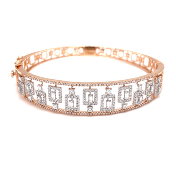 Broad bracelet with baguette in the centre with re...