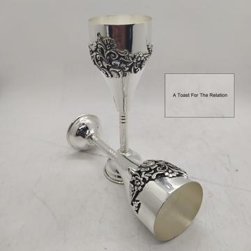 Puran hallmark silver wine glasses with fine carvi...