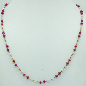 White freshwater round pearls with ruby gold taar...