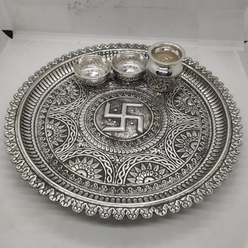 maanniyaa real silver antique pooja thali set in swastik carving work by Puran Ornaments