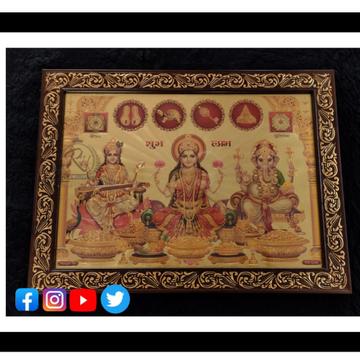 gold forming laxmi saraswati ganesh in frame