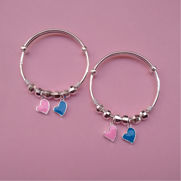 Pure silver baby bangles with Balls and Heart char...