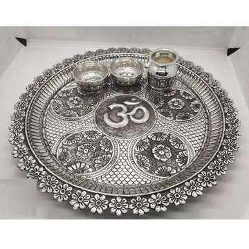 floral motifs carving pooja thali set in real silver by puran by Puran Ornaments