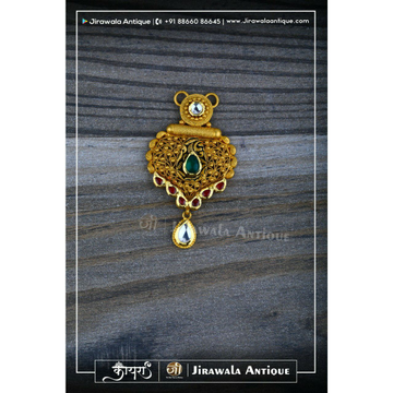 Antique gold jadau mangalsutra pendant with beni work.