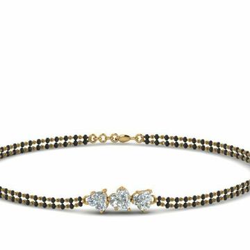 18KT yellow gold 3 heart diamond mangalsutra brace... by
