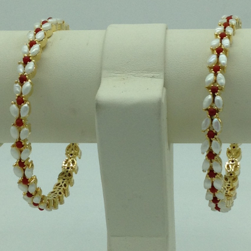 Freshwater White Button Pearls and Corals Bangles...