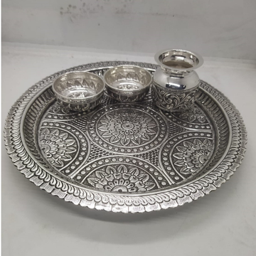 rangoli motif carving aarta set in real silver by puran by Puran Ornaments