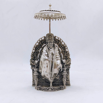 hallmarked silver sai baba idol in high antique fi...