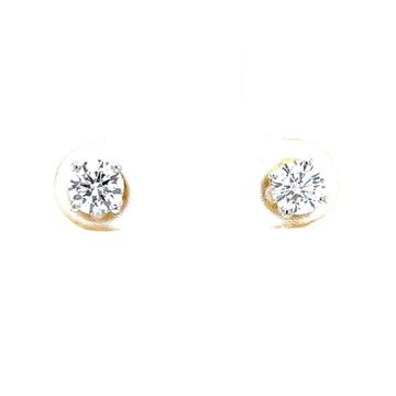 Single diamond studs in four prongs in yellow gold...