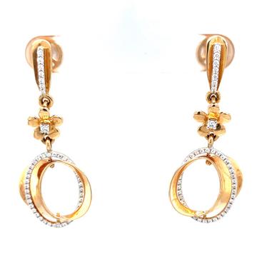 Étonnante dangling earrings with centre piece flow...