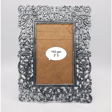 Pure silver photo frame in fine carvings po-171-05 by Puran Ornaments