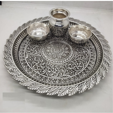 leaf finishing corner aarta thal in pure silver by puran by Puran Ornaments