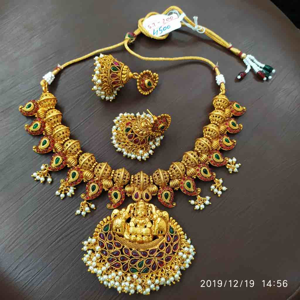 Gold plated necklace set with gemstone and murti design