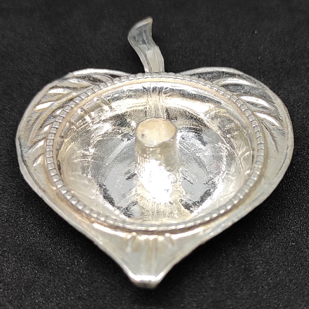 silver oil lamp