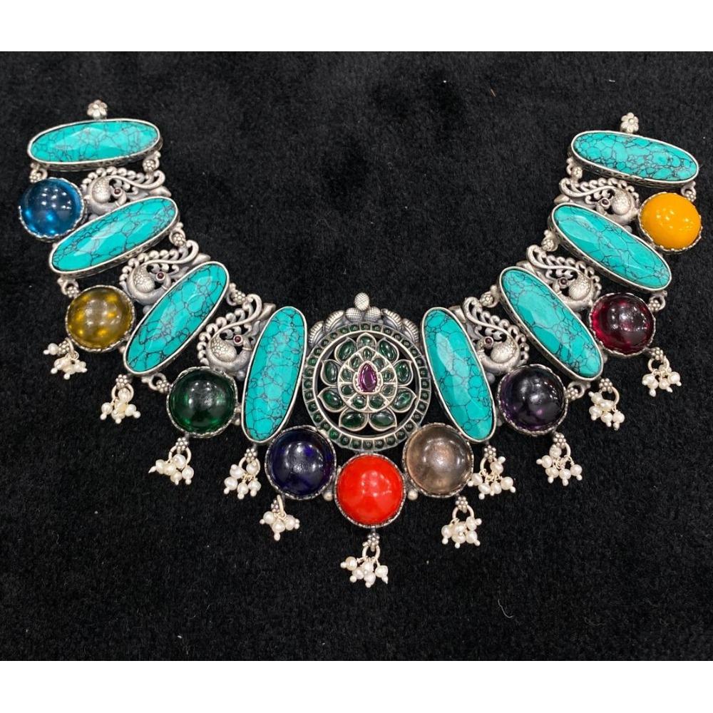 Statement choker neckalce with capsule shaped turqoise gems