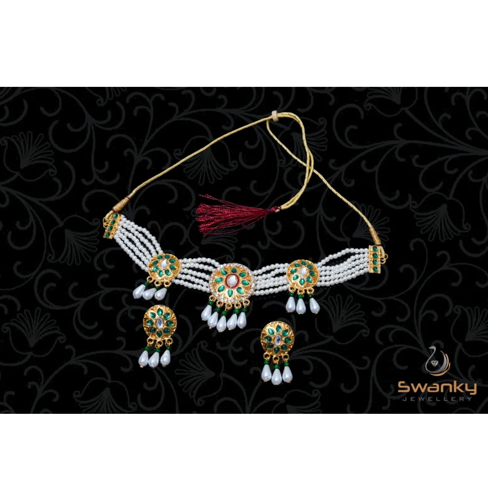 Attractive white pearl moti set with glass beads