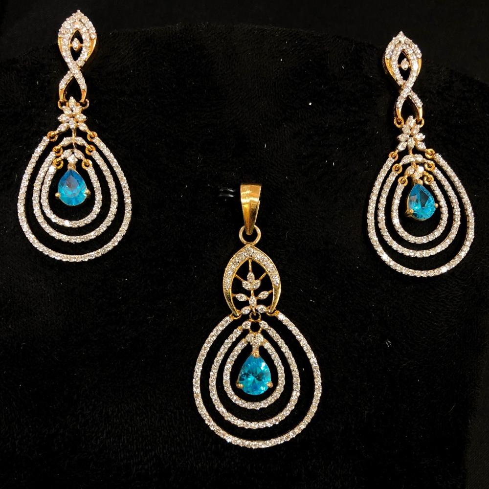 Attractive blue stone diamond pendant set