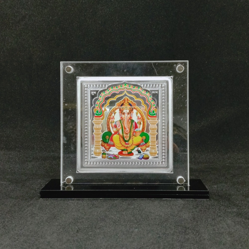Real silver designer coin of ganesha in color printing and yantra