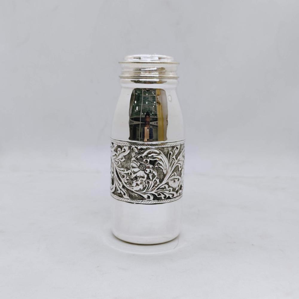 Hallmarked silver bottle in fine antique centre floral design carving