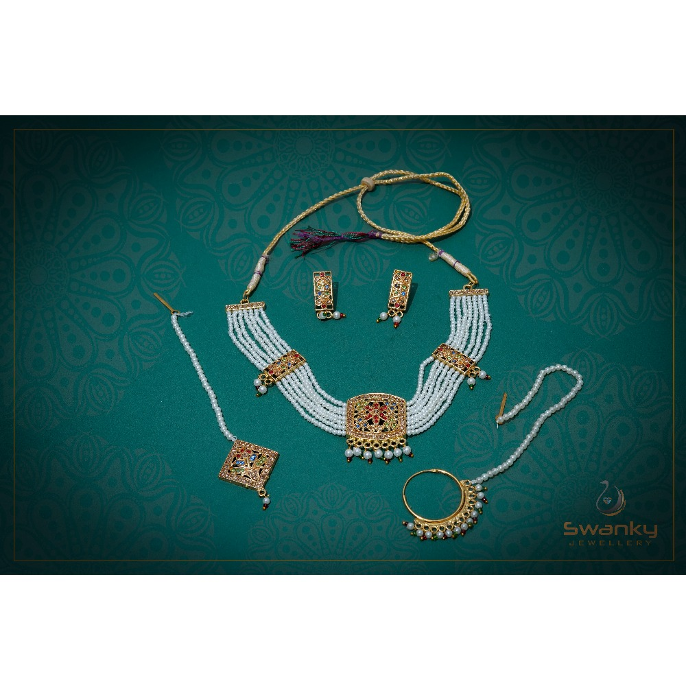 Attractive white pearl moti set with glass chatons