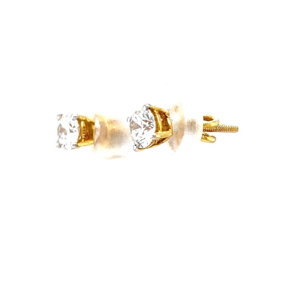 Single diamond studs in four prongs in yellow gold 0top160