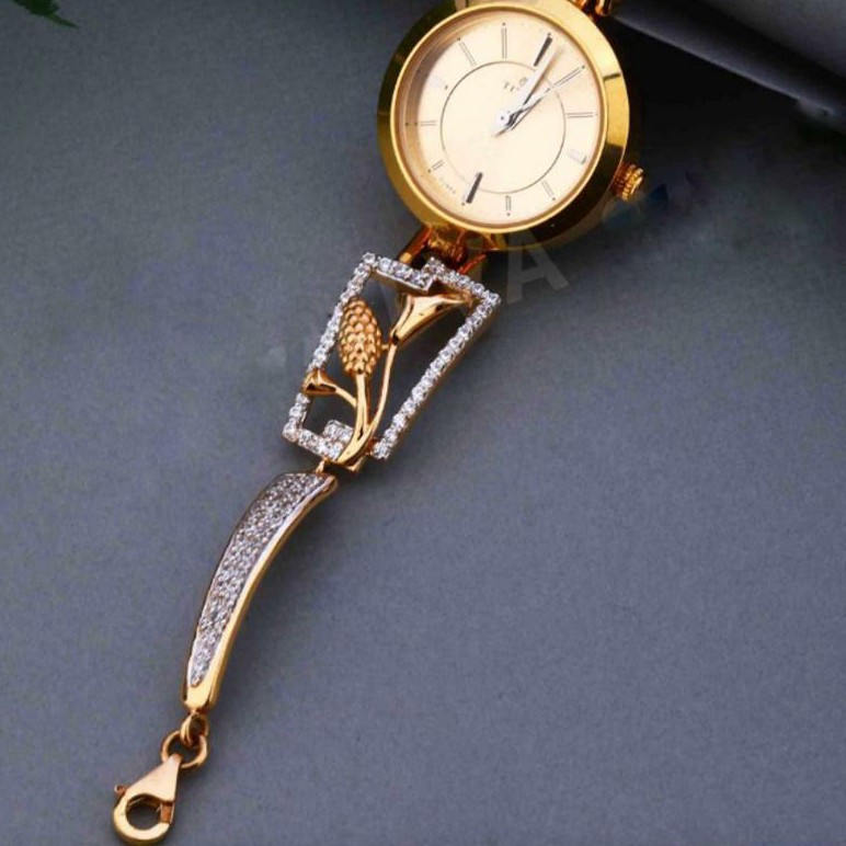 18KT Yellow Gold fancy round dial watch for Ladies